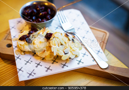 Beautiful presentation Syrnikov sausages with cherry and almond flakes stock photo, Beautiful presentation Syrnikov sausages with cherry and almond flakes. by Sergiy Artsaba