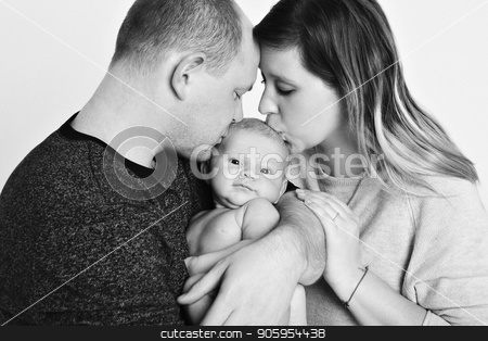 newborn baby lying on the hands of parents stock photo, newborn baby lying on the hands of parents by aaalll3110