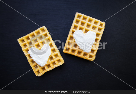 Delicious belgian waffles with cream on a black background. stock photo, Delicious belgian waffles with cream on a black background by Sergiy Artsaba