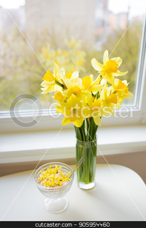 Posy of bright yellow daffodils on white wooden table. stock photo, Posy of bright yellow daffodils on white wooden table by Sergiy Artsaba