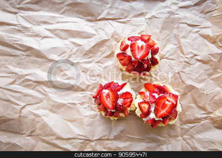 Beautiful and bright cupcakes with strawberries, delicious and simple stock photo, Beautiful and bright cupcakes with strawberries, delicious and simple. by Sergiy Artsaba