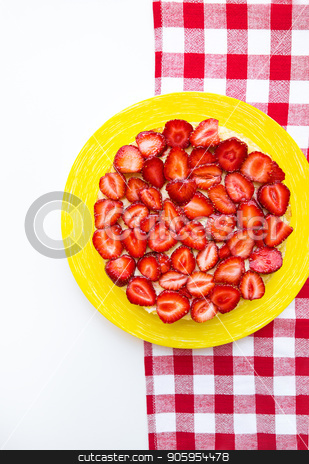 Bright and delicious strawberry cake on a red napkin in a cage stock photo, Bright and delicious strawberry cake on a red napkin in a cage. by Sergiy Artsaba