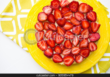 Beautiful and delicious strawberry cake stands on a yellow napkin stock photo, Beautiful and delicious strawberry cake stands on a yellow napkin. by Sergiy Artsaba