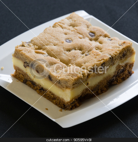 A slice of a coffee cake on a plate stock photo, A slice of a coffee cake on a plate with crumbs by Shane Maritch