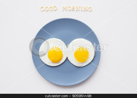 two beautiful eggs on a plate stock photo, two eggs on a plate and a yellow napkin, inscription Good Morning by Sergiy Artsaba