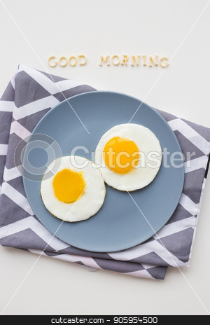 two beautiful eggs on a plate stock photo, two eggs on a plate, the inscription Good Morning by Sergiy Artsaba