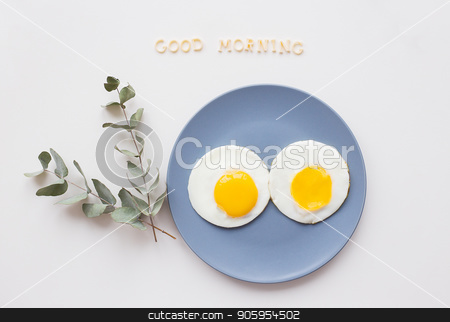two beautiful eggs on a plate stock photo, two eggs on a plate with a sprig of eucalyptus, an inscription good morning by Sergiy Artsaba