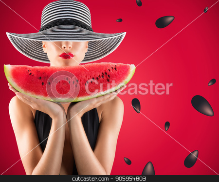 Girl in swimsuit with watermelon in hand and red background with seeds stock photo, Girl in swimsuit with fresh watermelon in hand and red background with seeds by Federico Caputo