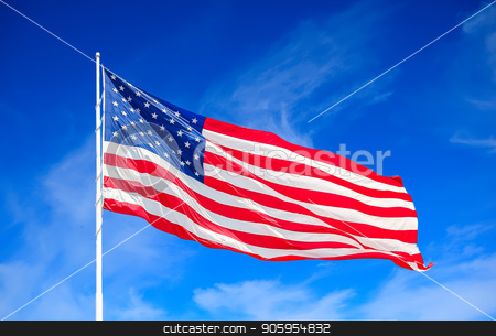 American Flag and Clouds stock photo, Large American flag blowing in the breeze against sky and clouds by Darryl Brooks