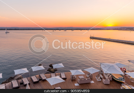 SYRACUSE, ITALY - sunset in front of the sea stock photo, Syracuse, Isle of Sicily, Italy. Sunset in front of the sea at the end of a spring day in May. by Paolo Gallo