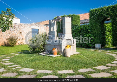 Vintage water well stock photo, Summer season in Italy. Desing water well in an elegant garden. by Paolo Gallo