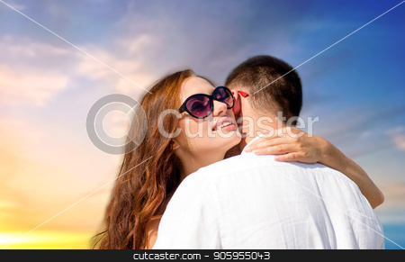 happy couple hugging over sunset sky background stock photo, love, summer and relationships concept - happy couple hugging over sunset sky background by Syda Productions