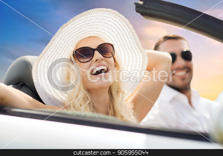 happy couple driving in convertible car over sky stock photo, road trip, travel and people concept - happy couple driving in convertible car over sky background by Syda Productions