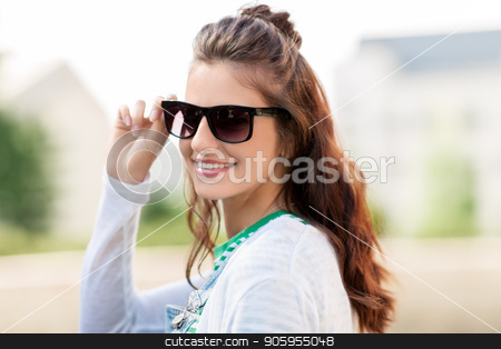 portrait of young woman in sunglasses outdoors stock photo, summer, eyewear and people concept - portrait of happy smiling young woman or teenage girl in sunglasses outdoors by Syda Productions