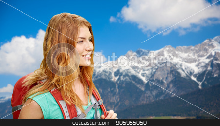smiling woman with backpack over alps mountains stock photo, adventure, travel, tourism, hike and people concept - smiling young woman with backpack over alps mountains background by Syda Productions