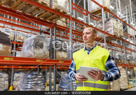 manual worker with tablet pc at warehouse stock photo, logistic business, technology, shipment and people concept - man or manual worker with tablet pc at warehouse by Syda Productions