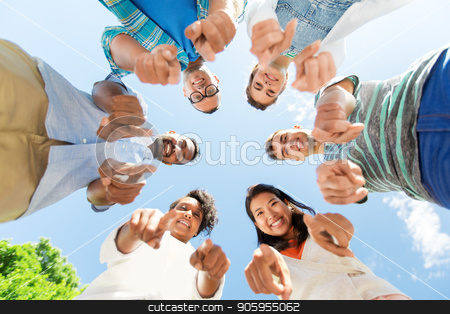 happy friends pointing at you standing in circle stock photo, people, friendship and international concept - group of happy smiling friends outdoors standing in circle and pointing at you by Syda Productions