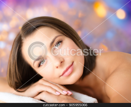 close up of beautiful woman at spa stock photo, wellness and beauty concept - close up of beautiful woman at spa over holidays lights background by Syda Productions