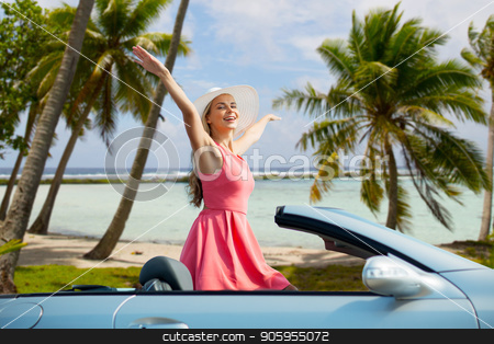 happy young woman in convertible car over beach stock photo, travel, summer holidays, road trip and people concept - happy young woman wearing hat in convertible car enjoying sun over tropical beach background in french polynesia by Syda Productions