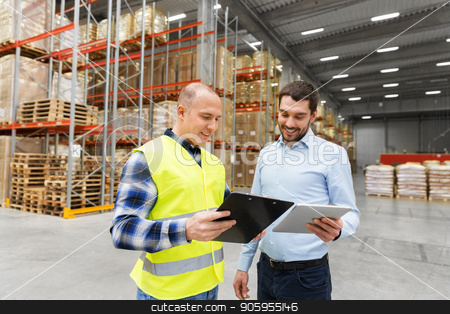 worker and businessman with tablet pc at warehouse stock photo, wholesale, logistic business and people concept - warehouse worker and businessman with clipboard and tablet pc computer by Syda Productions