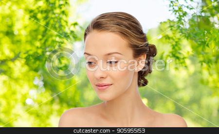 young woman face and shoulders stock photo, beauty and people concept - young woman face and shoulders over green natural background by Syda Productions