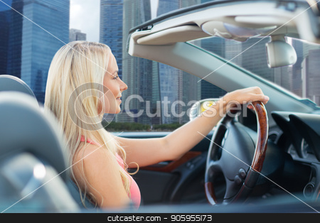 woman driving convertible car over singapore city stock photo, travel, road trip and people concept - happy young woman driving convertible car over singapore city skyscrapers background by Syda Productions