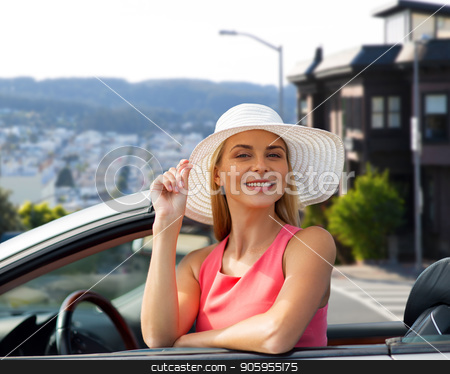 happy woman in convertible car over san francisco stock photo, travel, road trip and people concept - happy young woman wearing sun hat in convertible car over san francisco city background by Syda Productions