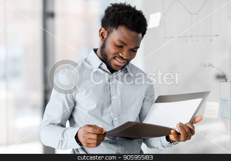 african american businessman with folder at office stock photo, business, people and corporate concept - african american businessman with folder at office by Syda Productions