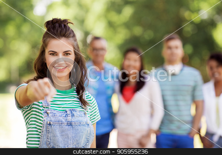 group of happy international friends outdoors stock photo, people, friendship and international concept - happy smiling woman pointing at you and group of happy friends outdoors by Syda Productions