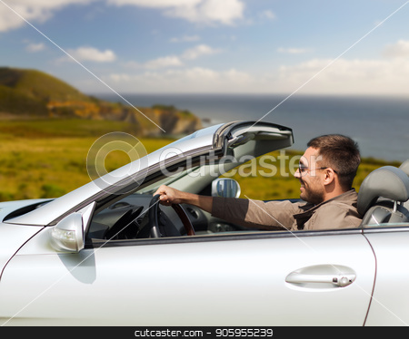 happy man driving convertible car stock photo, road trip, travel and people concept - happy man driving convertible car over big sur coast of california background by Syda Productions