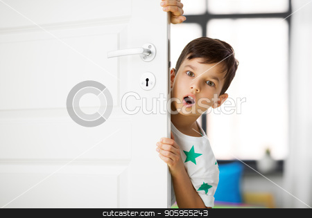 surprised little boy behind door at home stock photo, childhood, emotions and people concept - surprised little boy behind door at home by Syda Productions