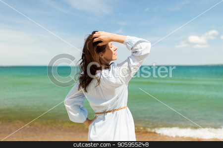 happy smiling woman on summer beach stock photo, people and leisure concept - happy smiling woman on summer beach by Syda Productions