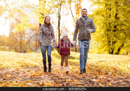 happy family walking at autumn park stock photo, family, season and people concept - happy mother, father and little daughter walking at autumn park by Syda Productions