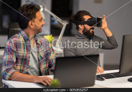 creative man in virtual reality headset at office stock photo, deadline, augmented reality and technology concept - creative man with virtual headset or 3d glasses at office by Syda Productions