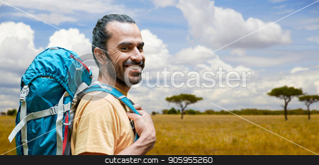 smiling man with backpack over african savannah stock photo, adventure, travel, tourism, hike and people concept - smiling man with backpack over african savannah background by Syda Productions