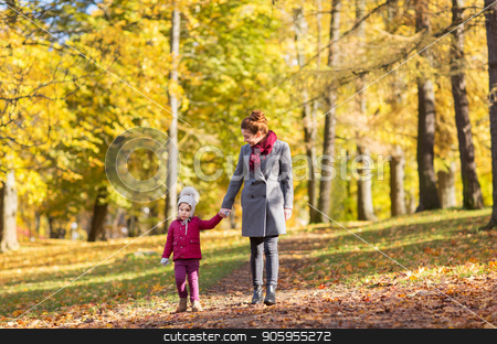 happy mother and little daughter at autumn park stock photo, family, season and people concept - happy mother and little daughter walking along autumn park by Syda Productions