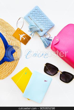Preparation for vacation - hat, glasses, passport, cosmetic bag, purse. Inscription-love stock photo, Preparation for vacation - hat, glasses, passport, cosmetic bag, purse Inscription-love by Sergiy Artsaba