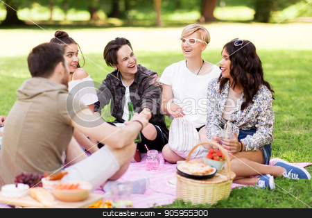 happy friends with drinks at summer picnic stock photo, friendship and leisure concept - group of happy friends with non alcoholic drinks and food at picnic in summer park by Syda Productions