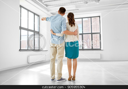 happy couple hugging at new home stock photo, mortgage, people and real estate concept - happy couple hugging at new home from back by Syda Productions