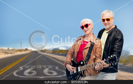 senior couple with electric guitar over route 66 stock photo, rock music, old age and travel concept - happy senior couple with electric guitar over us route 66 background by Syda Productions