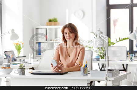 businesswoman with smartphone working at office stock photo, business, technology and people concept - businesswoman with smartphone working at office by Syda Productions