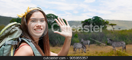 happy woman with backpack over savannah stock photo, adventure, travel, tourism, hike and people concept - smiling young woman with backpack over zebras in african savannah background by Syda Productions