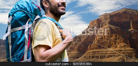 close up of man with backpack over grand canyon stock photo, adventure, travel, tourism, hike and people concept - close up of smiling man with backpack over grand canyon national park background by Syda Productions