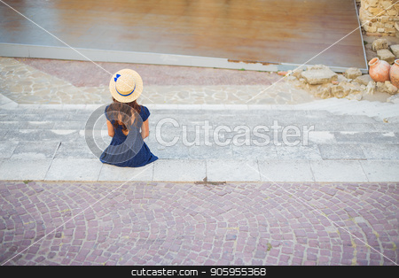 The girl is sitting with her back in the amphitheater. Bulgaria, Nessebar stock photo, The girl is sitting with her back in the amphitheater. Bulgaria, Nessebar. by Sergiy Artsaba