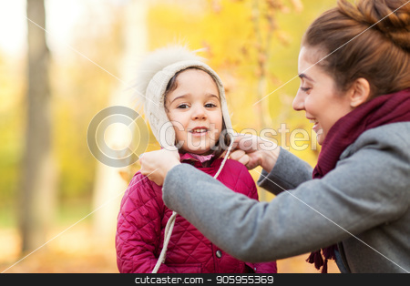 happy mother and little daughter at autumn park stock photo, family, season and people concept - happy mother and little daughter at autumn park by Syda Productions
