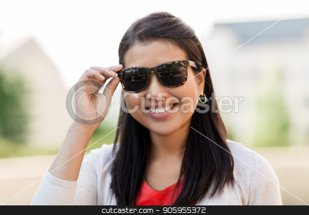 portrait of young woman in sunglasses outdoors stock photo, summer, eyewear and people concept - portrait of happy smiling young woman in sunglasses outdoors by Syda Productions