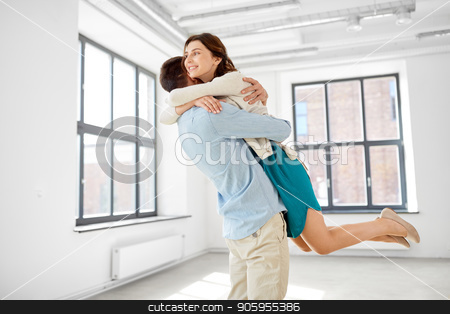happy couple hugging at new home stock photo, mortgage, people and real estate concept - happy couple hugging at new home by Syda Productions