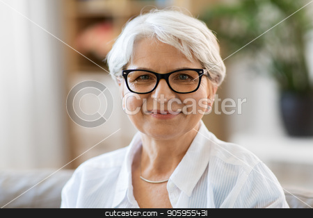 portrait of happy senior woman in glasses stock photo, vision, age and people concept - portrait of happy senior woman in glasses by Syda Productions