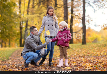 happy family with maple leaf at autumn park stock photo, family, season and people concept - happy mother, father and little daughter with maple leaf at autumn park by Syda Productions