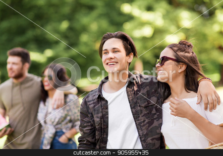 happy couple with friends at summer park stock photo, people and leisure concept - happy couple with friends at summer park by Syda Productions